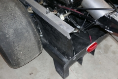 Left-rear-diffuser-and-side-plate-with-body-clip-down14733